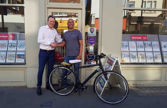Smiles all round! Chris from Whitman & Co greets Manish, the winner of the cycle raffle